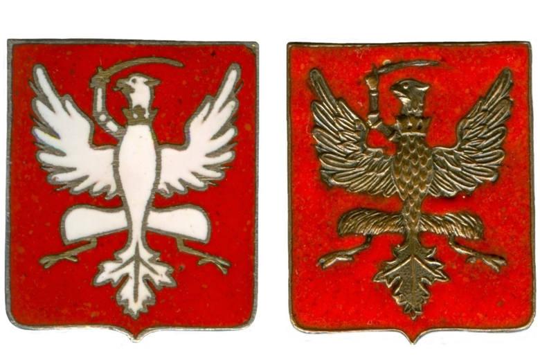Emblematy wykonane z metalu i pokryte emalią. Wprowadzono je  na krótko przed wybuchem  II wojny światowej