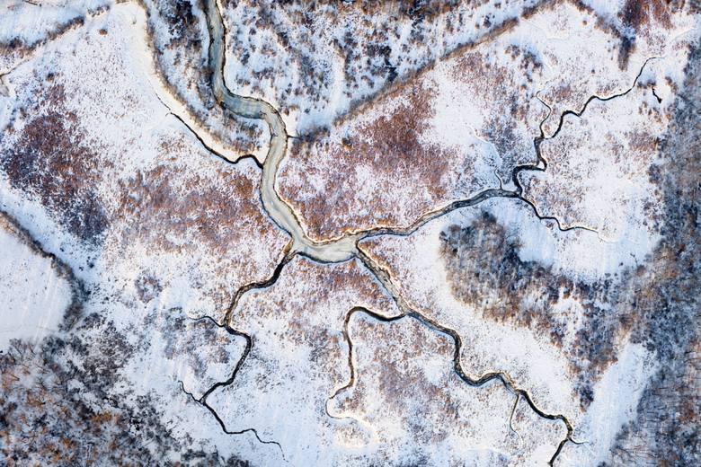 Zamarznięta rzeka jak tiramisu na zdjęciach Filipa Wolaka w Wozowni