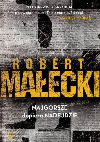 """Robert Małecki to autor poczytnych kryminałów, których akcja rozgrywa się w Toruniu. W trylogii złożonej z: """"Najgorsze dopiero nadejdzie"""","""