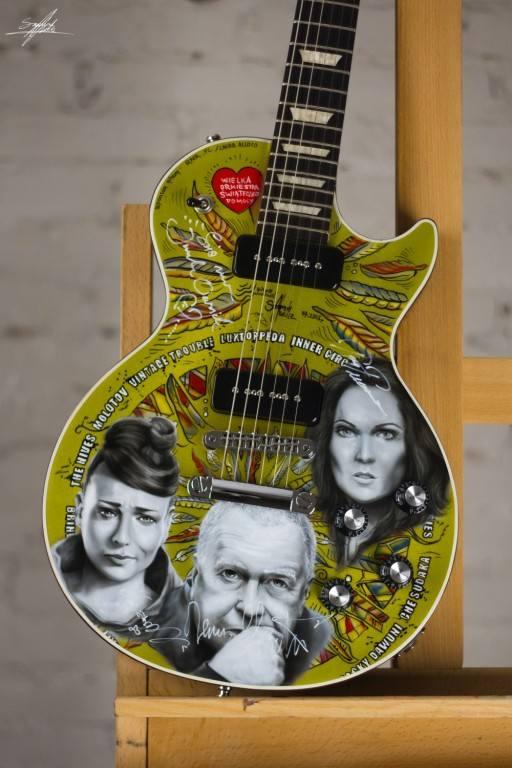 Gitara Gibson Les Paul&rsquo;50s pomalowana przez Szymona Chwalisza z wizerunkami i autografami artyst&oacute;w, kt&oacute;rzy wystąpili podczas 22. Przystanku Woodstock.<br /> <br /> Obecna cena: 3 050 zł <br />...