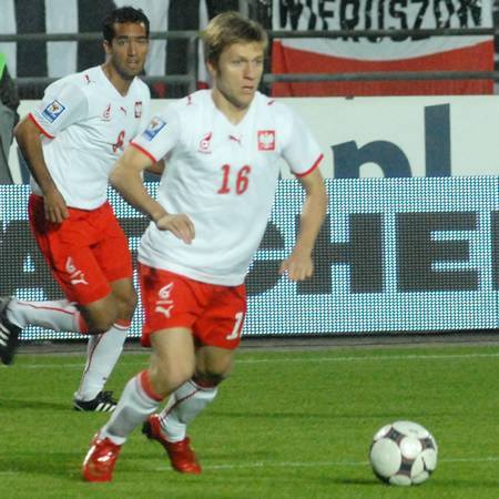 Przy piłce gwiazda meczu Jakub Błaszczykowski, za nim ten od którego też zależało bardzo wiele Roger Guerreiro