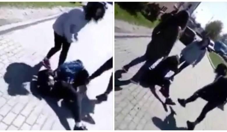 Kadr z filmu, na którym dwie nastolatki brutalnie biją koleżankę przed gimnazjum na gdańskim Chełmie