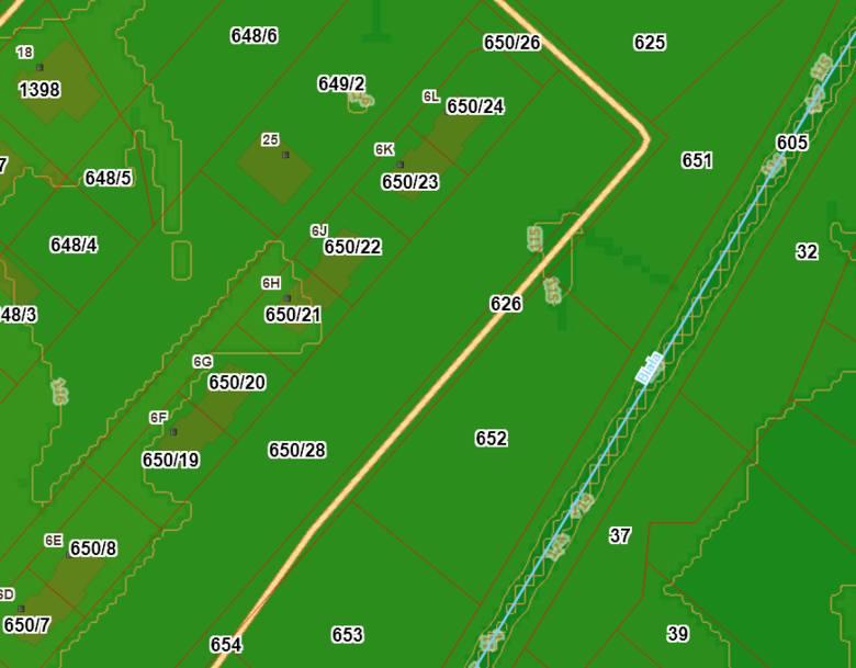Mapa z zaznaczonymi poziomicami wysokości gruntu.