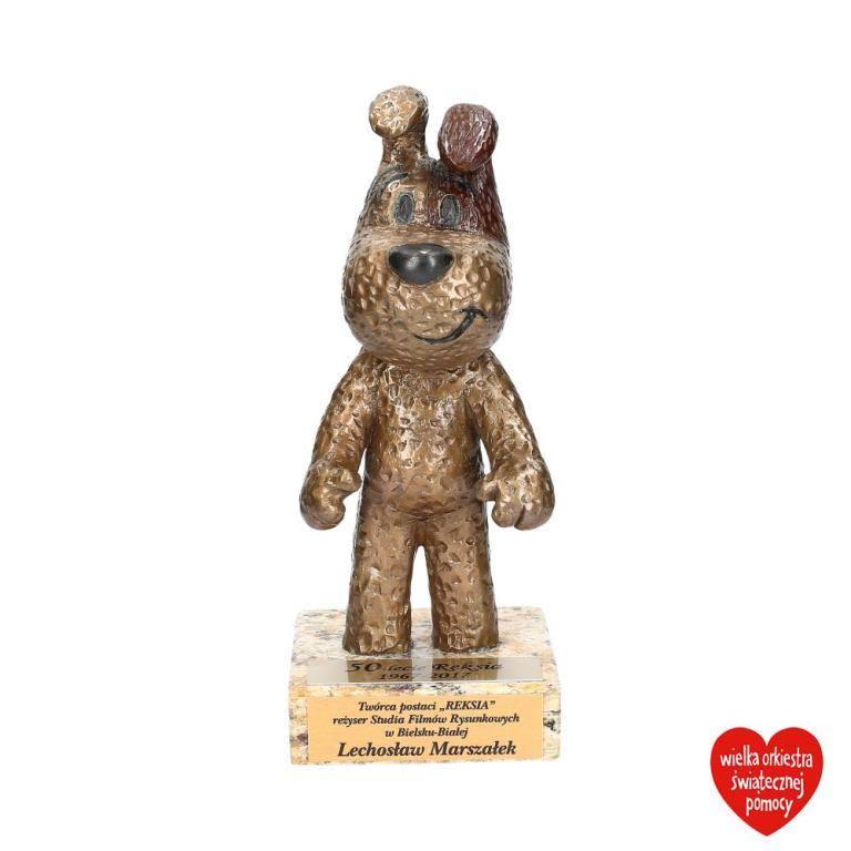 Wyjątkowa figurka Reksia, którą na 50-lecie bajkowego psa otrzymał jego twórca - Lechosław Marszałek.<br /> <br /> Obecna cena:  4 550 zł<br /> <strong><a href=