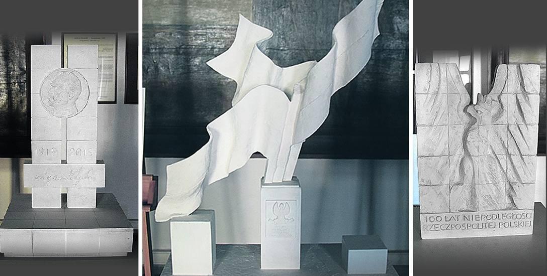 Trzy zgłoszone projekty, w środku znajduje się zwycięski pomysł - artysty Roberta Tomaka