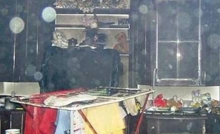 Strażacy uratowali kobietę z płonącego budynku