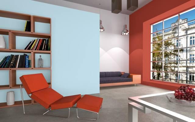 Jasną kolorystykę wnętrza w stylu miejskim warto urozmaicić kontrastowo pomalowaną ścianą.