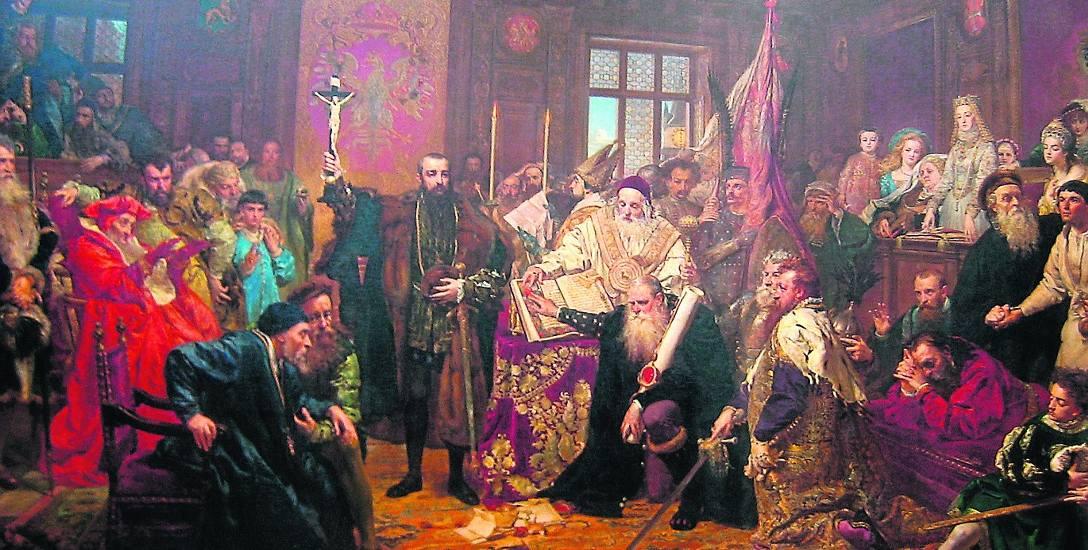 """Obraz """"Unia lubelska"""" Jan Matejko namalował w 1869 r. Centralną postacią dzieła jest król Zygmunt II August, unoszący krzyż. Z mieczem w ręce klęczy"""