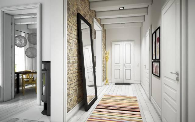 Jeśli w wąskim przedpokoju chcemy mieć dywanik w paski, warto by były one ułożone prostopadle do dłuższych ścian.